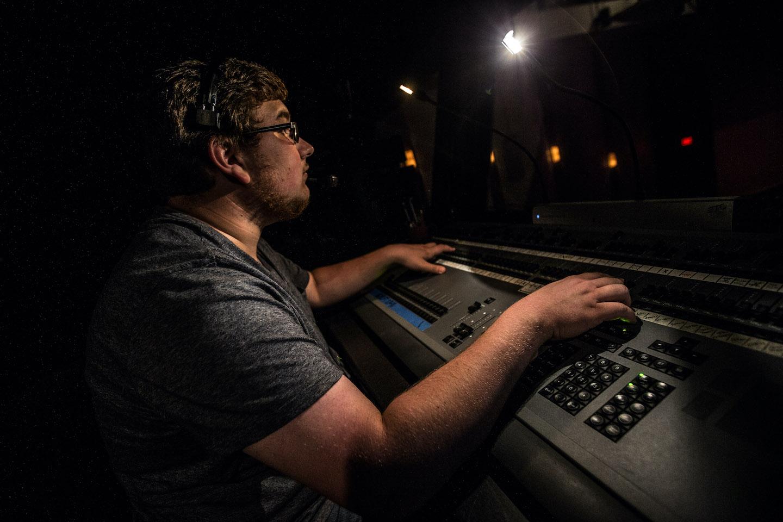 Midland University Technical Arts Student Working on Sound Board