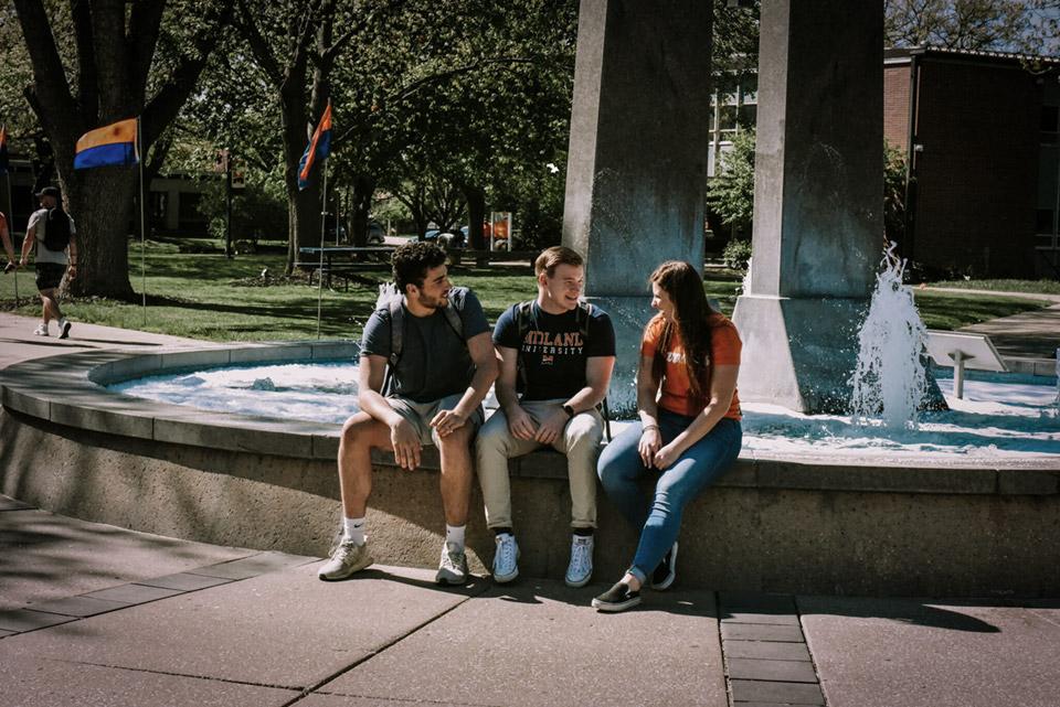 Midland University Students Sitting Outdoors on Campus